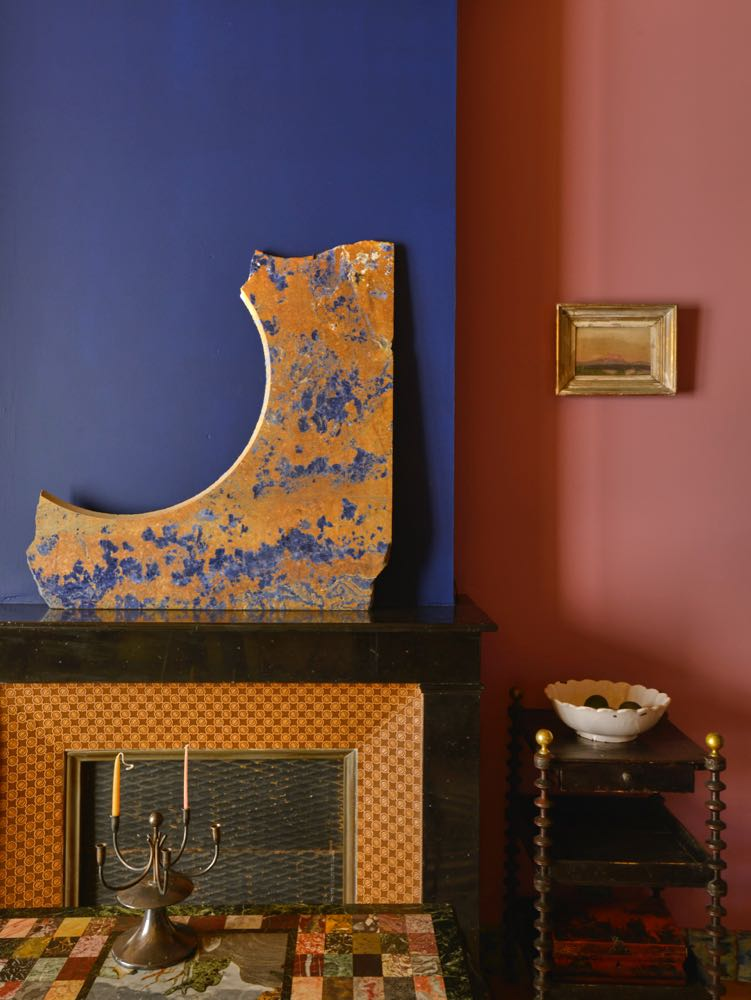 An off-cut of a marble circular table top has become a objet d'art above the fireplace in the lounge room. The blue of the marble's veining matching the paint work in an uncanny fashion.