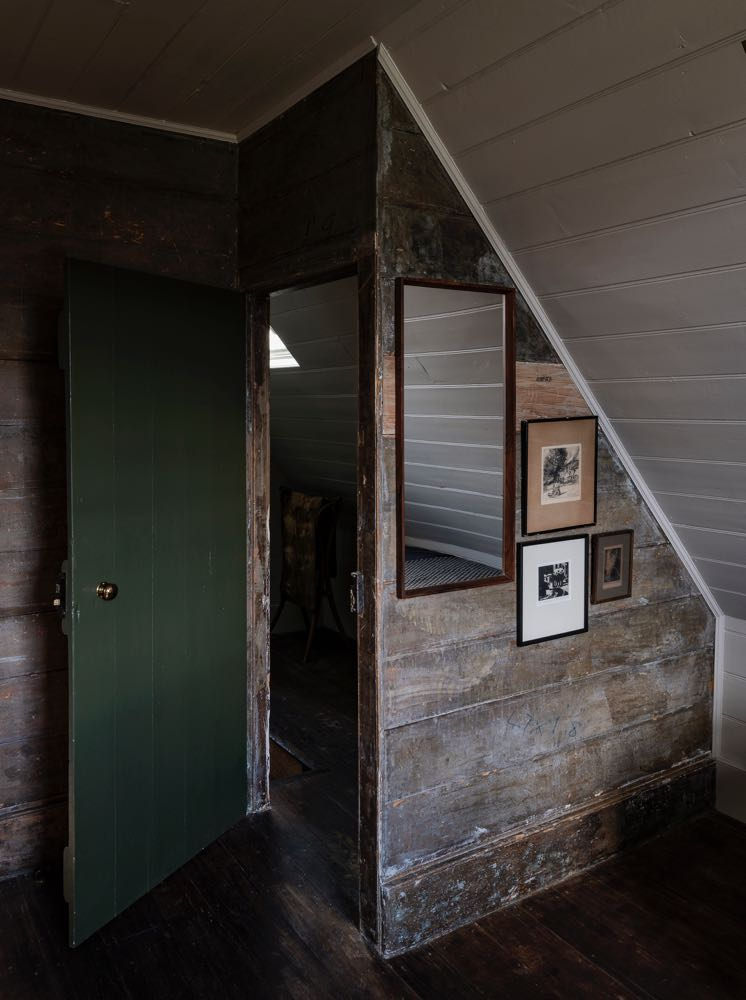 An attic room in Captain Kelly's Cottage -Bruny Island, Tasmania. The combination of worn paint and solid green is extremely successful.