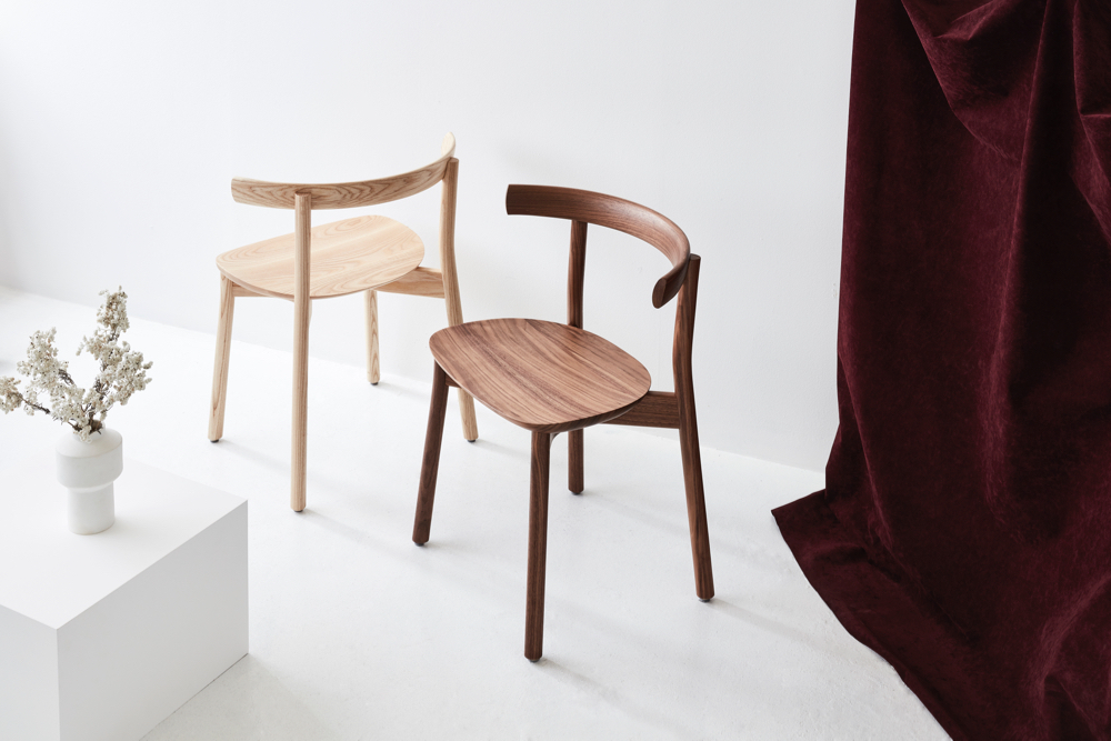 The Torii chair by Chris Nicholson for Dessein Furniture shown here in natural ash (left) and walnut (right).
