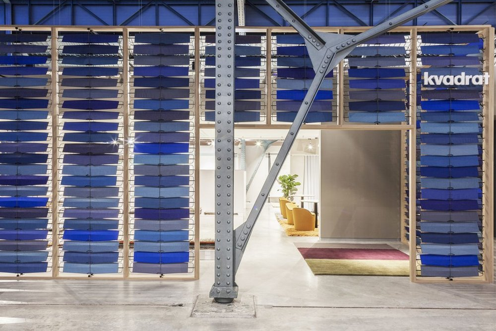 The Kvadrat stand at imm Cologne designed by GamFratesi celebrated colour and fabric in a beautiful way.