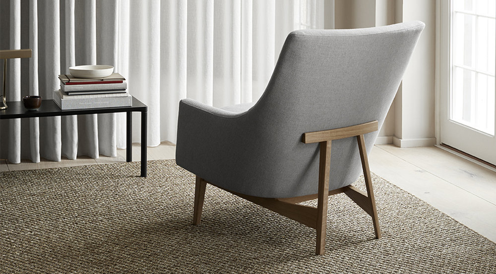 Jens Risom's classic 'A-Chair ' from 1961 revived by Danish brand Fredericia. Avaialble in solid oak, walnut, black lacquered steel or matt chrome.