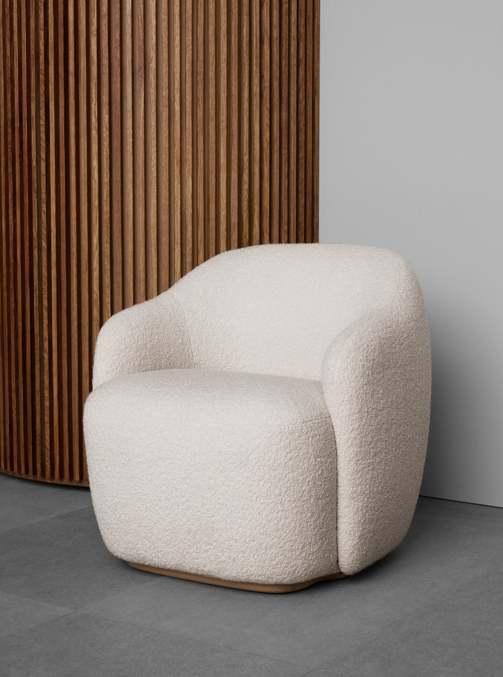 Fogia's new 'NIche' armchair by Andreas Engesvik in white boucle fabric was a big hit as it offers many of the qualities of the popular Danish classic the  'TIred Man chair' by Flemming Lassen  but in a rounded, compact form.