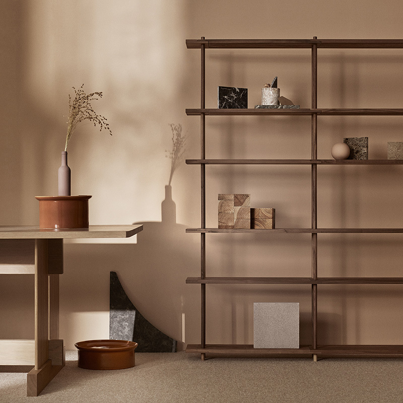 Fogia released a new freestanding and wall mounted shelving system called 'Bond' that combines delicate turned uprights and floating shelf planes. Various configurations are available including wall mounted asymmetric options.