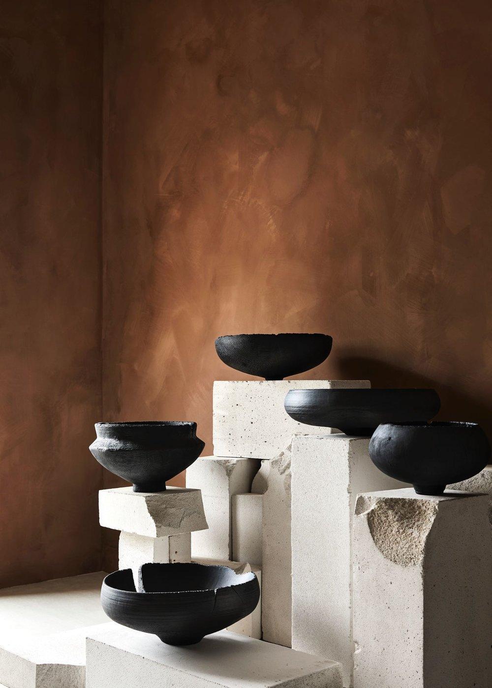 The beautiful work of Makiko Ryujin balancing on delightfully distressed plinths.