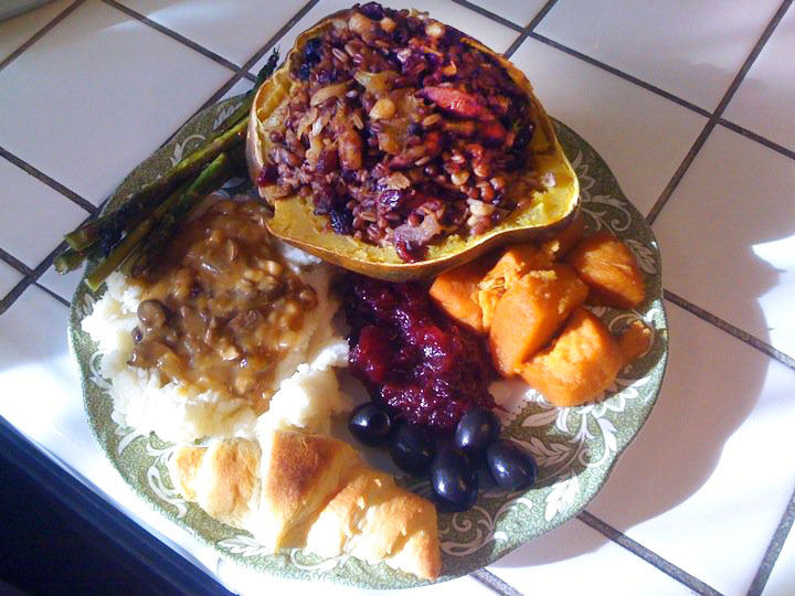 Holiday Stuffed Cup with baked sweet potato, cranberry sauce, black olives, Pillsbury Crescent Roll, mashed potatoes, mushroom gravy, and roasted asparagus