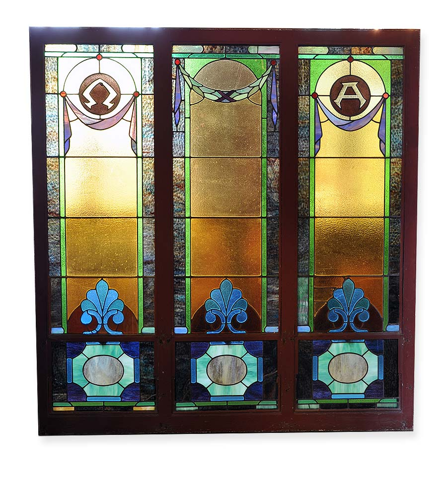 Stained glass panels featuring alpha omega