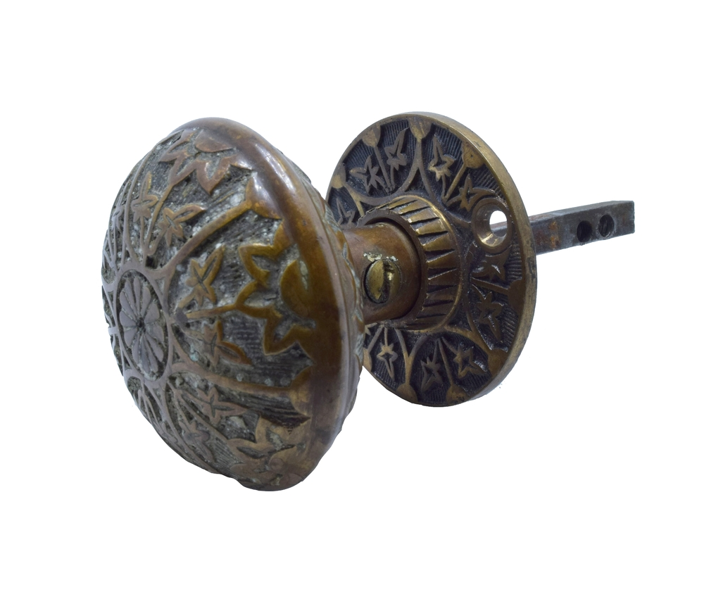 H20038-eastlake-cast-brass-door-knob-set-center-flower-KNOB-AND-ROSETTE-ANGLE.jpg