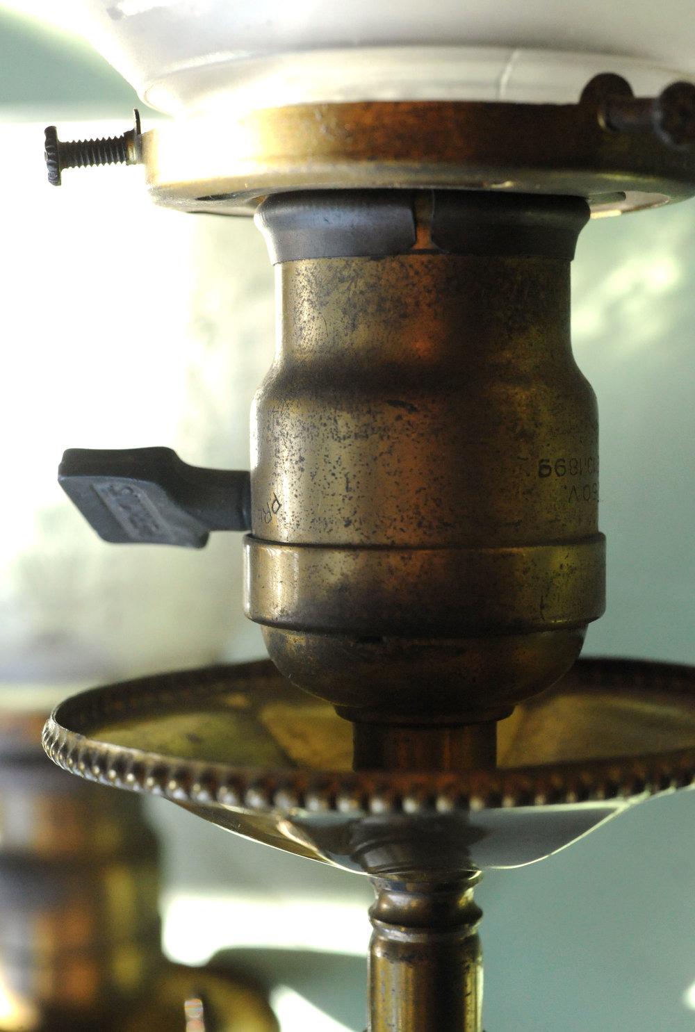 42022-griffin-three-arm-sconce-brass-detail.jpg
