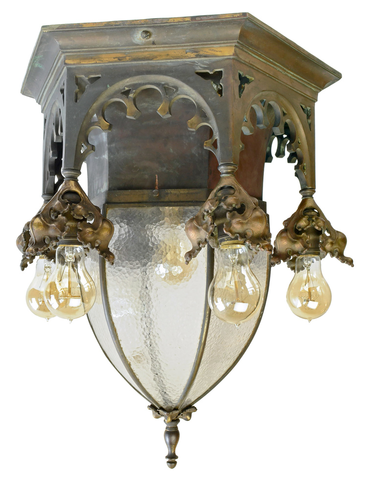 early 20th century cast bronze gothic fixture with bent glass shade