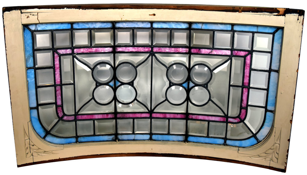 curved victorian window with clam roundels