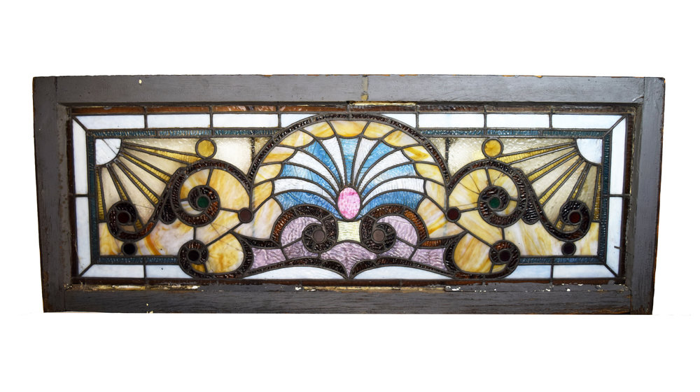 ornate victorian transom with blue urn design