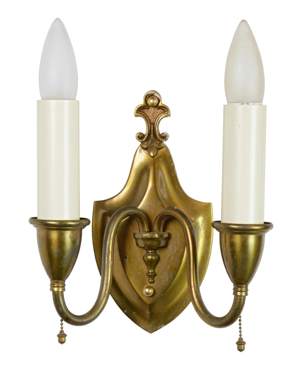 cast brass sconce with fleur-de-lis