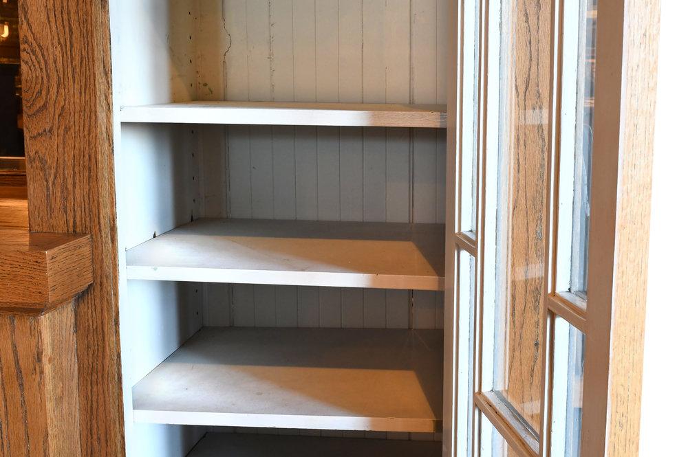 47513-golden-oak-buffet-shelf-detail.jpg