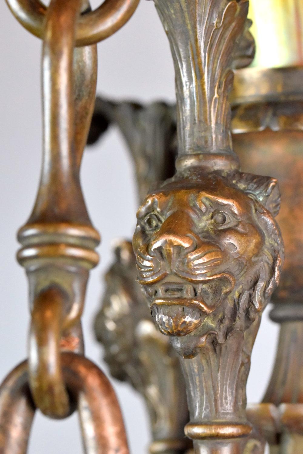 47590-cast-bronze-nine-light-chandelier-lion-head.jpg