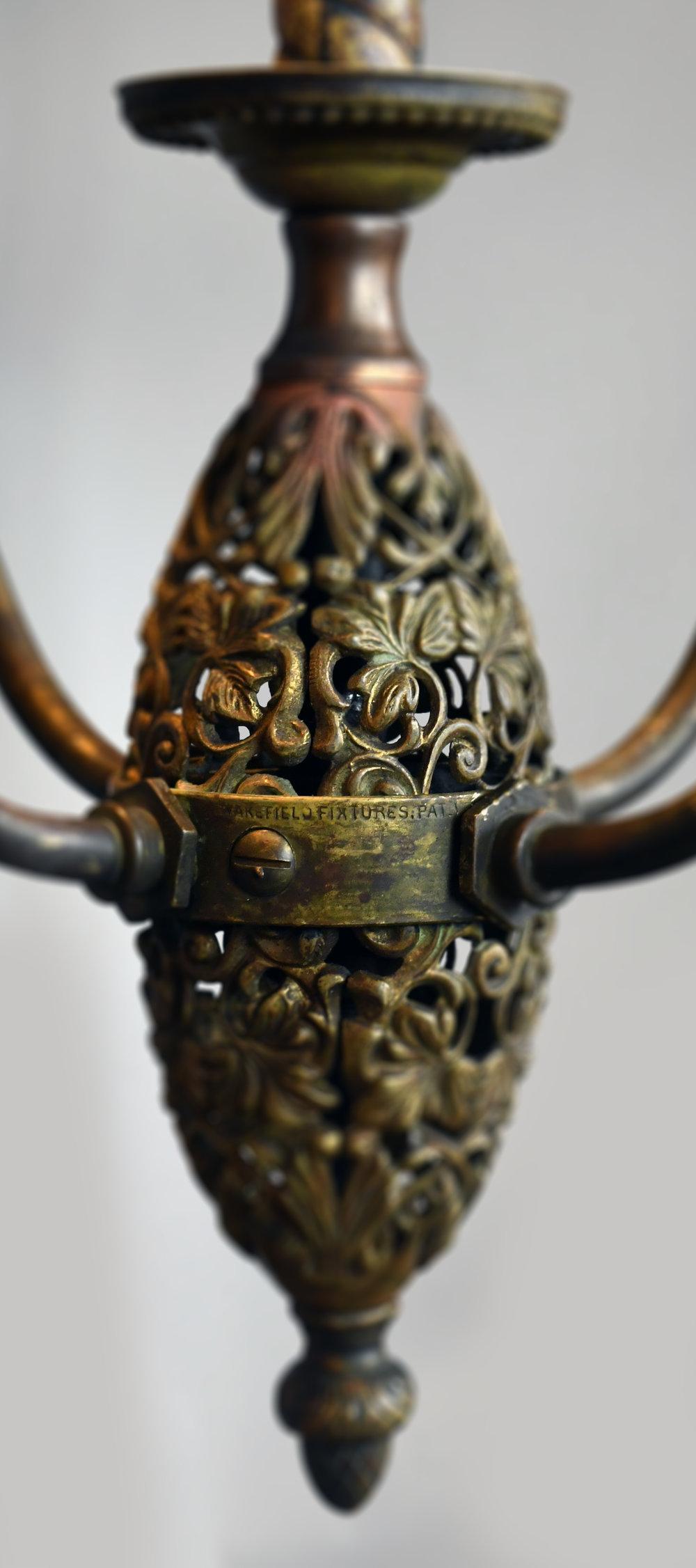 47597-brass-4-arm-chandelier-detail-2.jpg