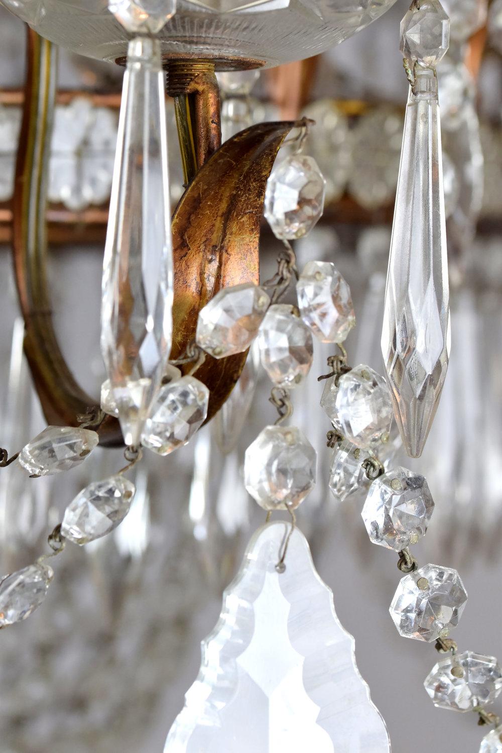 47666-12-light-crystal-chandelier-metal-arm.jpg