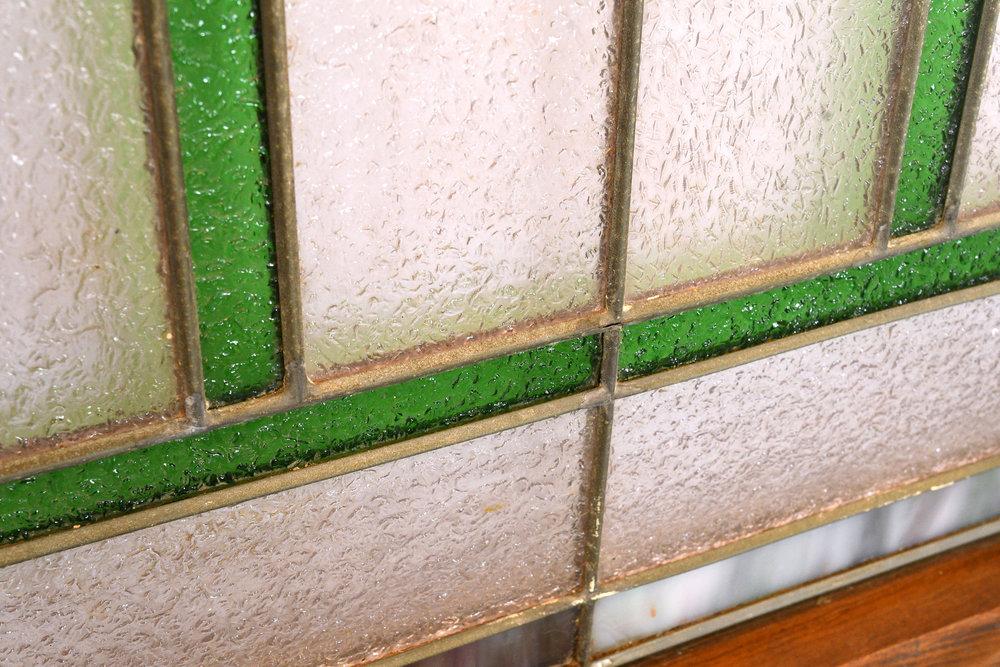 47447-green-purple-stained-glass-flower-window-detail.jpg