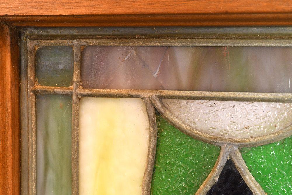 47447-green-purple-stained-glass-window-crack.jpg
