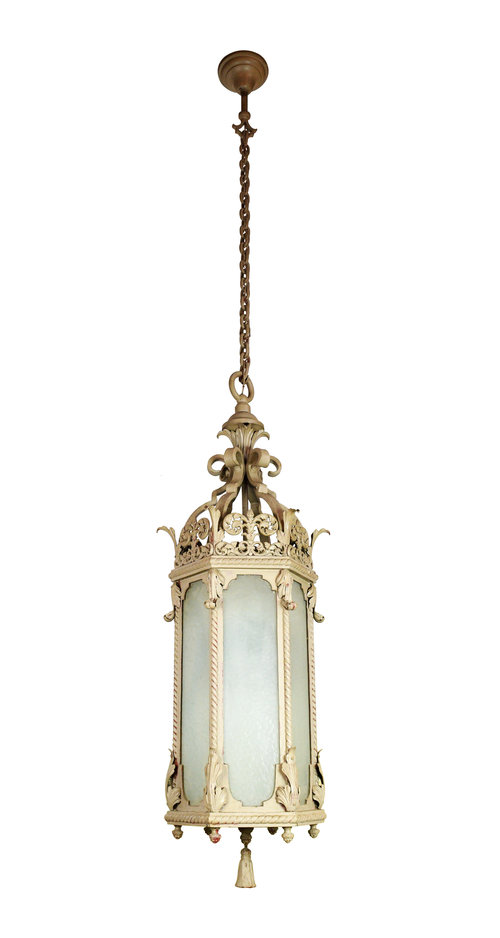 """Six Sided 48"""" Pendant Iron & Glass   This tall iron theater light makes a definite statement piece. The iron body and chain compliments textured glass on each of the six sides. The details on this light are bold: a chunky metal tassel hangs from the bottom and a heavy chain suspends it from the ceiling, while detailed floral filigree adds adds a sense of delicacy and grace..   THERE ARE 7 OF THESE!"""
