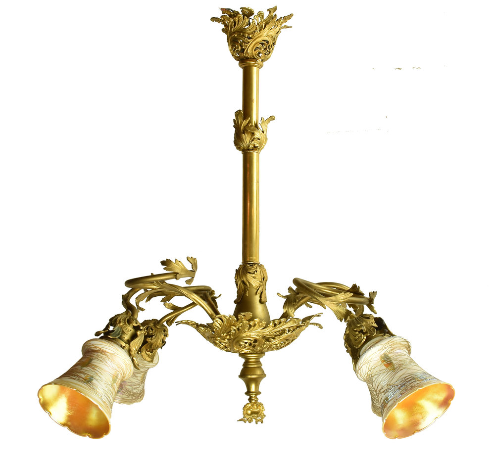 ornate chandelier with quezal shades