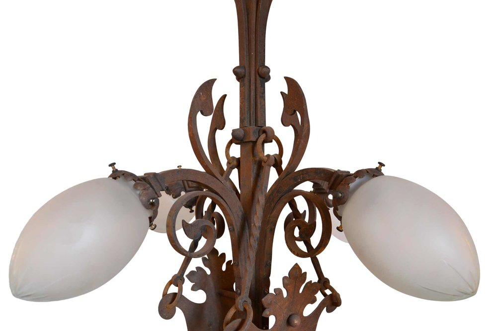 45968-iron-4-arm-chandelier-with-griffon-crest-detail-arm.jpg