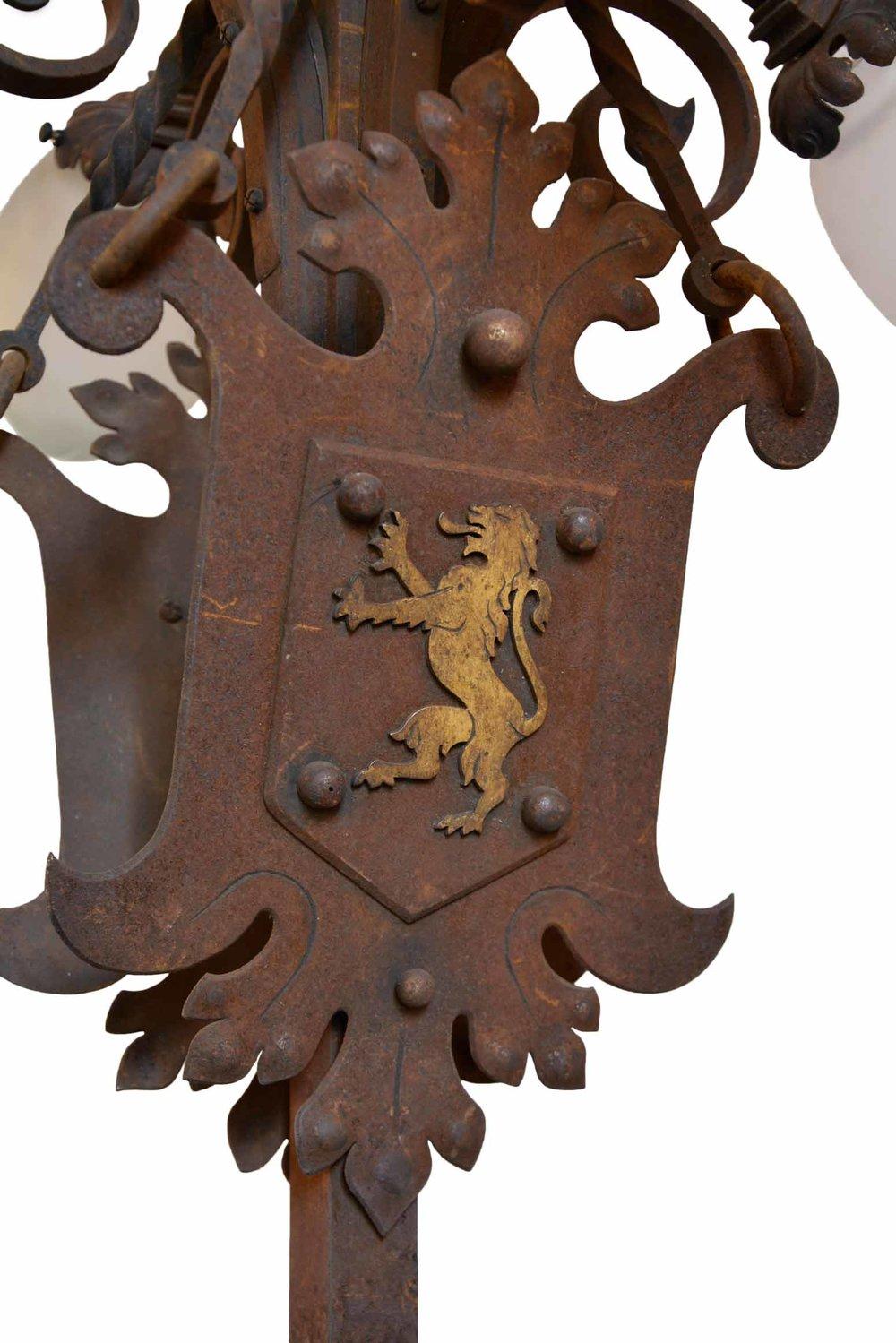 45968-iron-4-arm-chandelier-with-griffon-crest-detail-lion.jpg