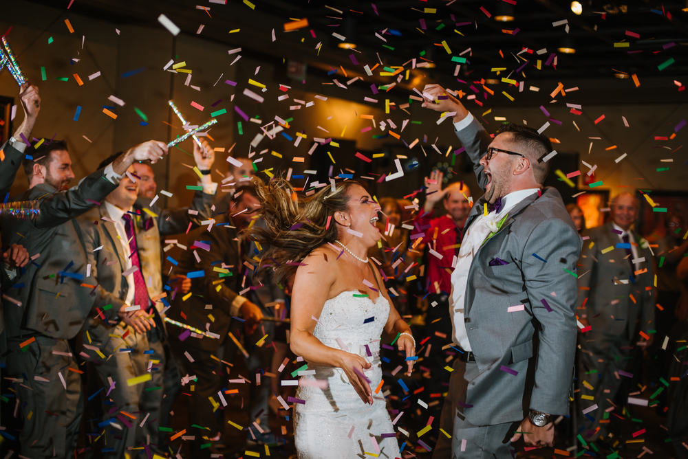 Allison and Pete have smiles that big pretty much 24/7 and when their wedding party threw confetti on them during the intros into their reaction it was priceless!