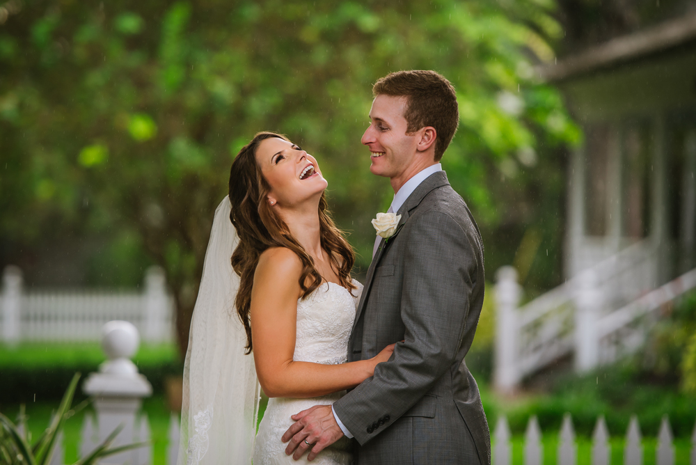 Well it's pretty obvious by now that being a wedding photographer in Florida means that you have to know how to work with the rainy weather. Amanda and Nolan had a beautiful day at the B&B and even when a few showers went by they were laughing and in love!