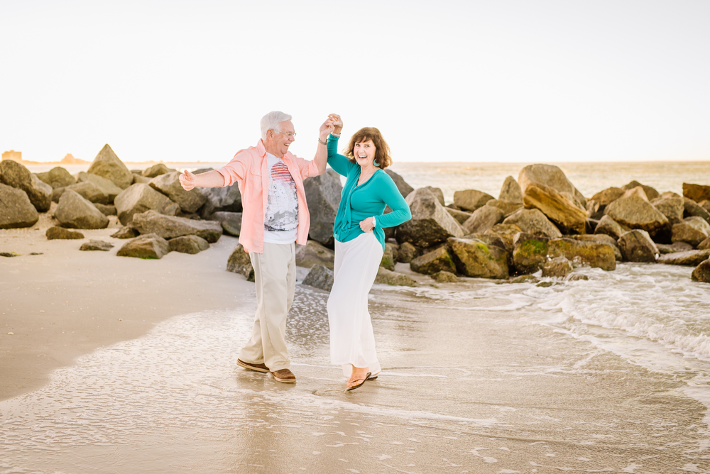 tampa-engagement-photographer-beach-sunrise-senior-couple-old-elderly-happy-candid-young-dance-twirl-rocks-gold