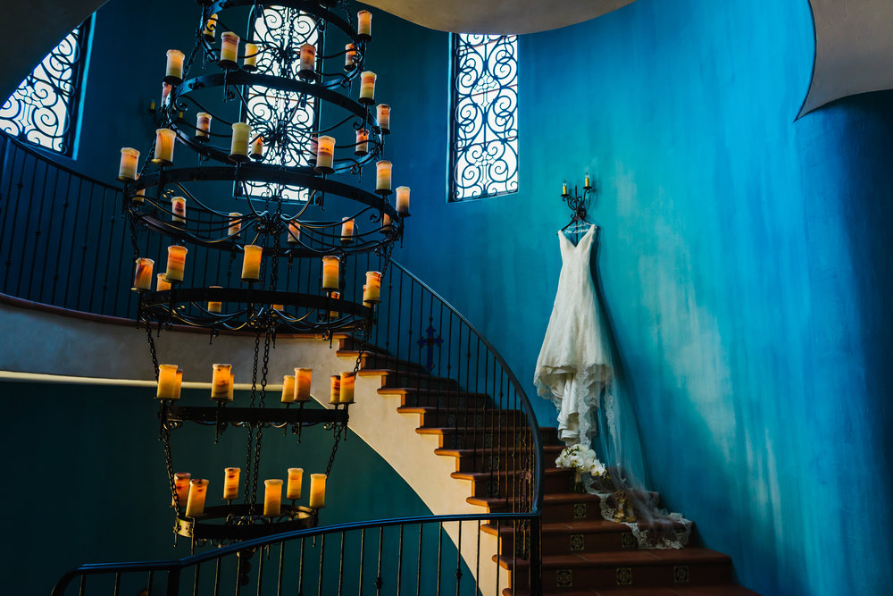Tampa-Wedding-Photographer-Mision-Lago-Dress-Staircase-Chandelier.jpg