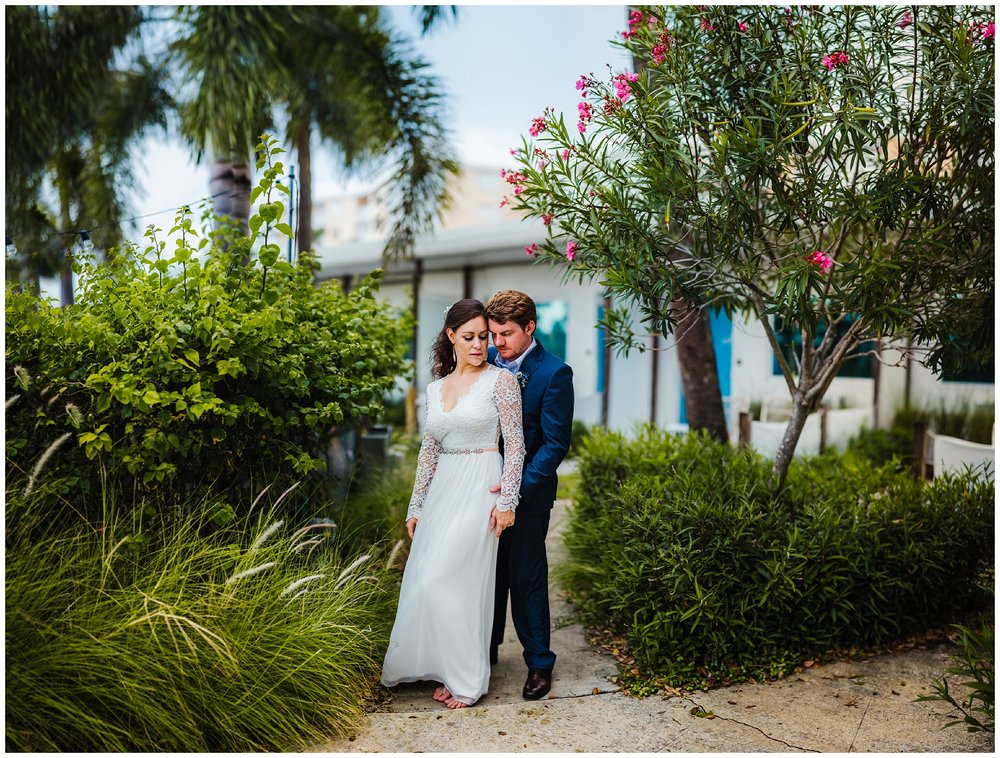 st-pete-wedding-photographer-postcard-inn-sleeve-dress-rain-sunset_0195.jpg