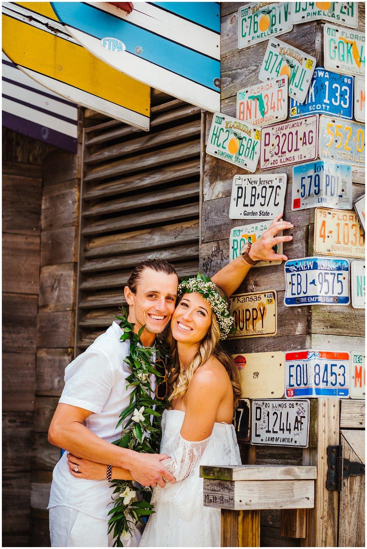 tampa-bay-wedding-photographer-barefoot-post-card-inn-tropical-hawaiin-lei-pink-pineapples-flower-crown_0155.jpg