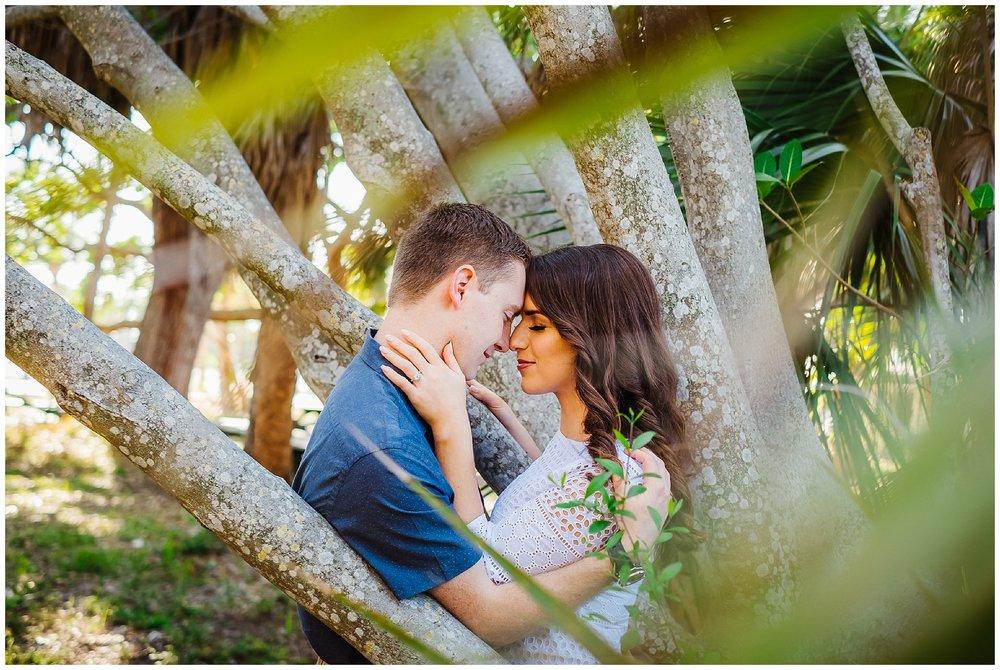 tampa-fort de soto-beach-green dress-water-love-engagement_0011.jpg