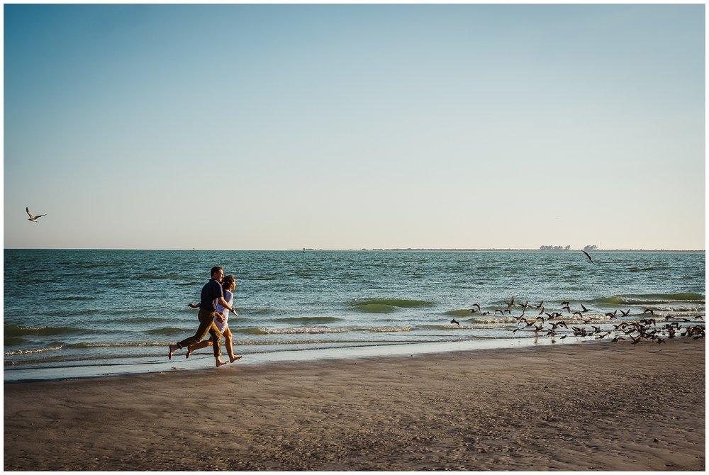 tampa-fort de soto-beach-green dress-water-love-engagement_0025.jpg