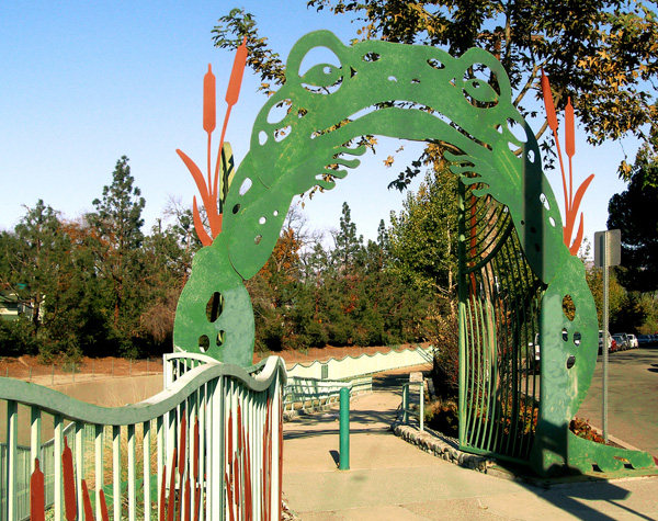 A steel toad gate was designed by elementary school students for the entrance to the Valleyheart Greenway linear park.  Source:   KCET