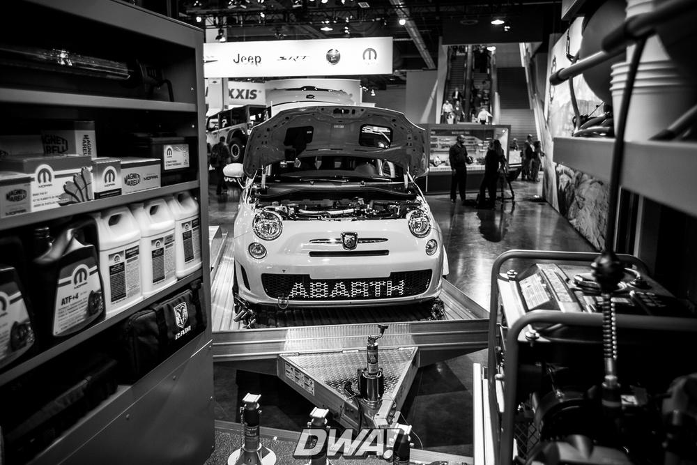 Fiat Abarth behind a Ram ProMaster Van