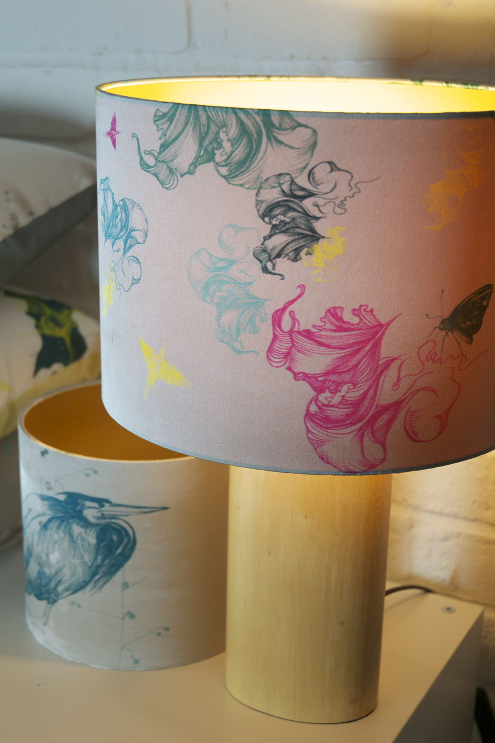 Flight and Heron lampshades with gold linings.