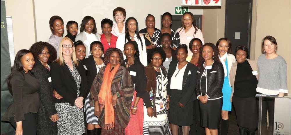 Tumi Frazier pictured with Paula Noble Fellingham (back row centre), founder of the Women's Information Network at the recent Global Women's Summit held in Johannesburg, South Africa