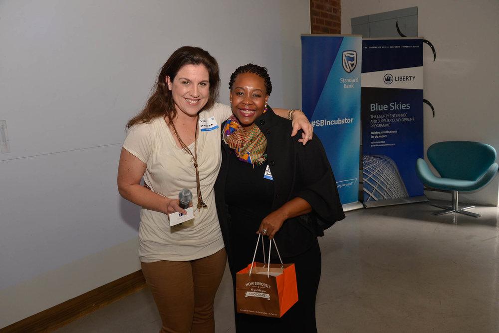 Bonini Botle Kusano receives her fabulous Chocoloza gift hamper from Vicki Bain