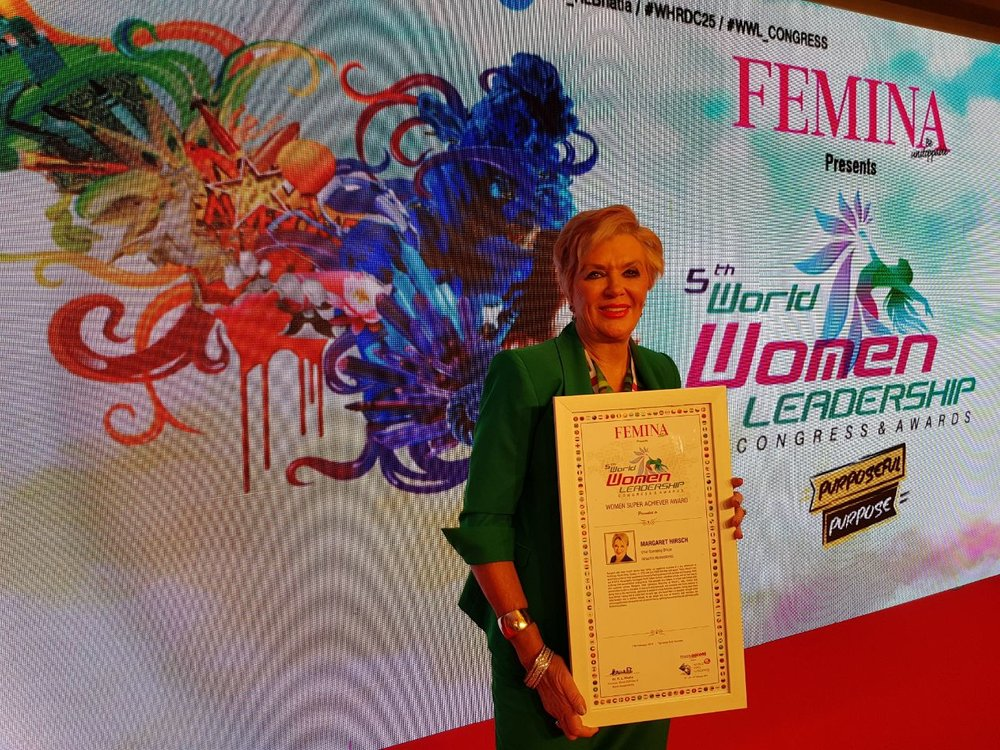 Margaret Hirsch receiving her Impactful Social Innovators award in India