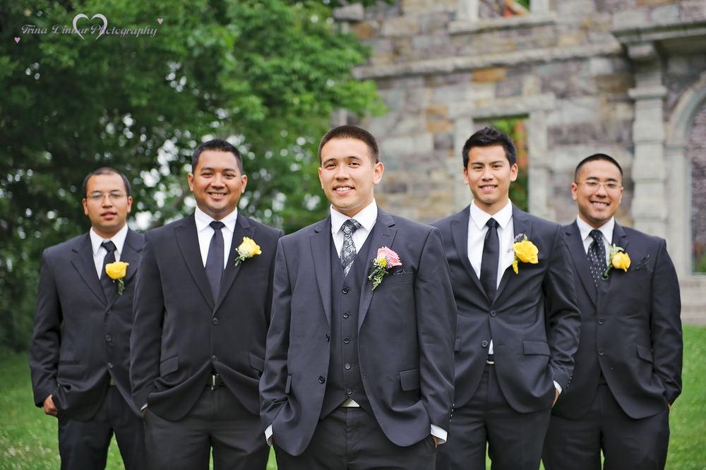 Groom and his groomsmen following the wedding ceremony near Portland, Maine