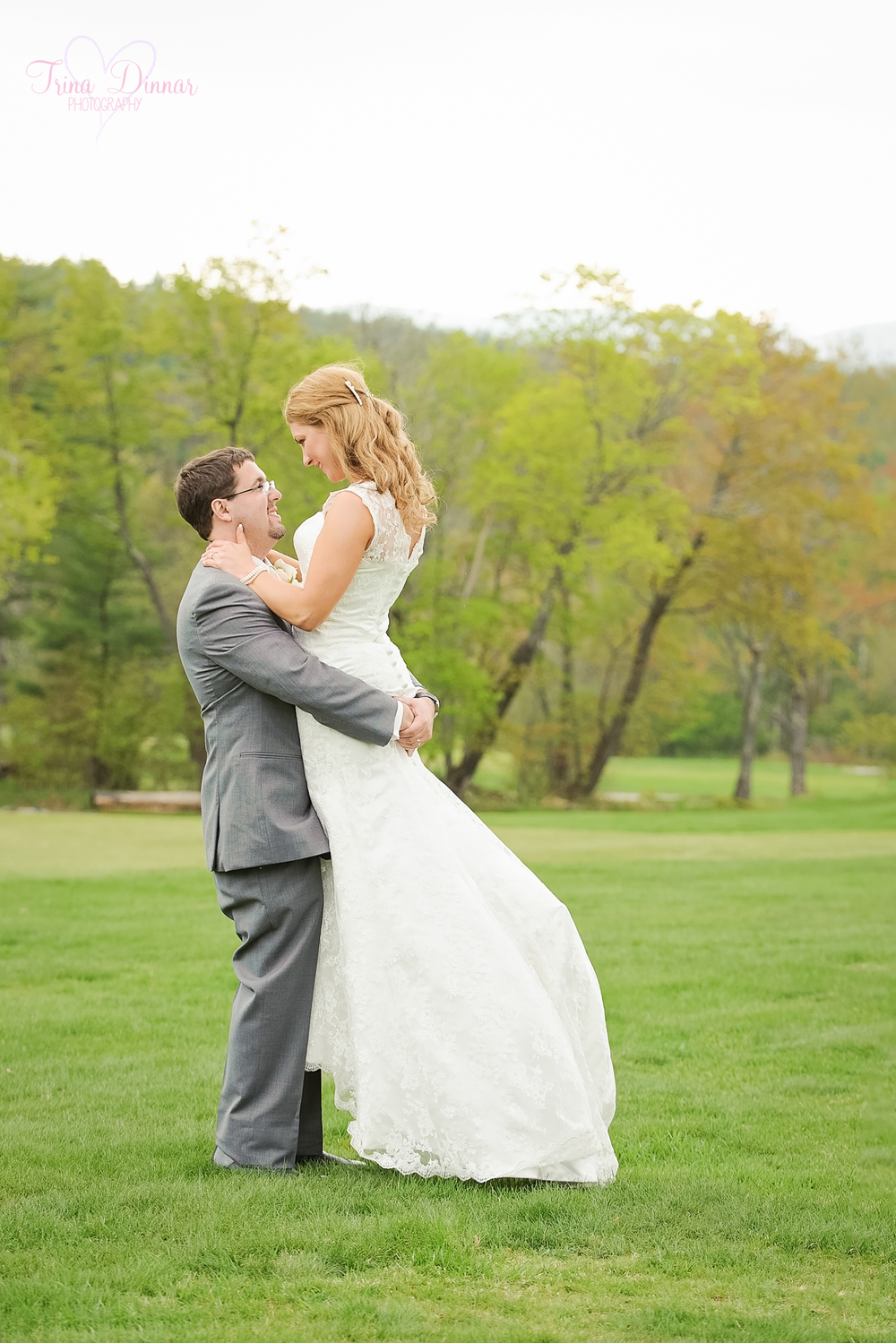 Southern Maine wedding photographer traveling throughout ME and NH. Bride and Groom kiss on the golf course.