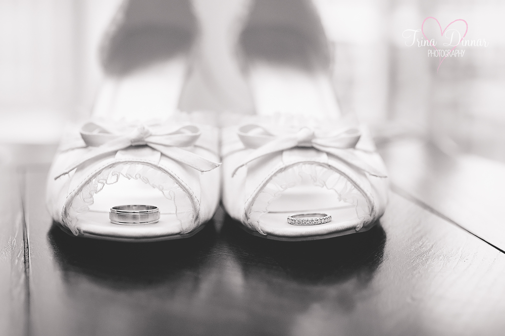 Maine photographer detail photography: wedding bands on brides wedding shoes.