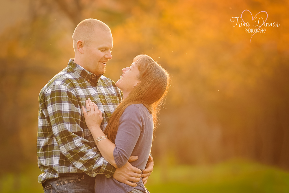 Couple embrace for their Engagement session. I will soon be their Maine wedding photographer.
