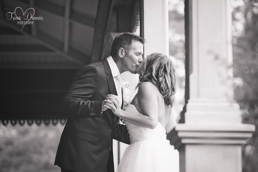 Bride and Groom steal kisses on their wedding day