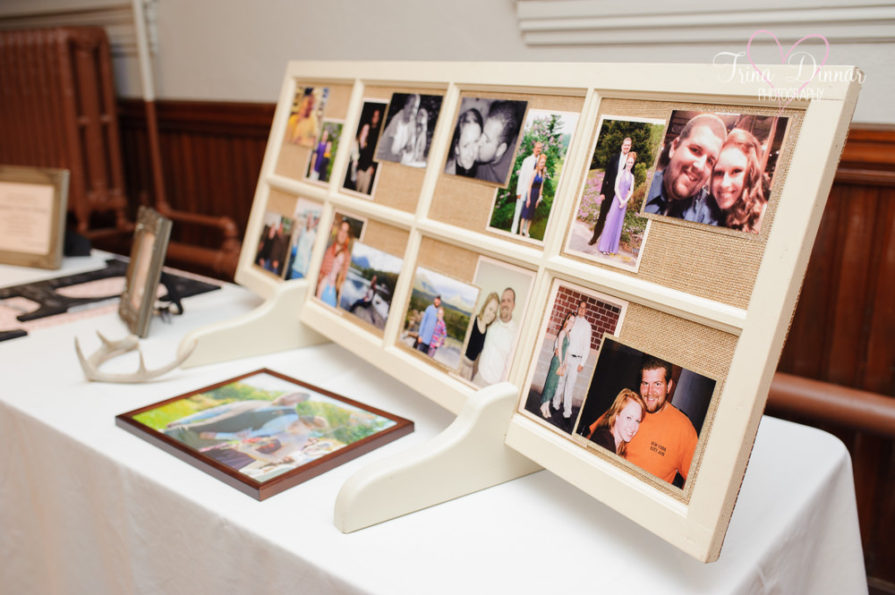 Maine wedding photos displayed at wedding reception.