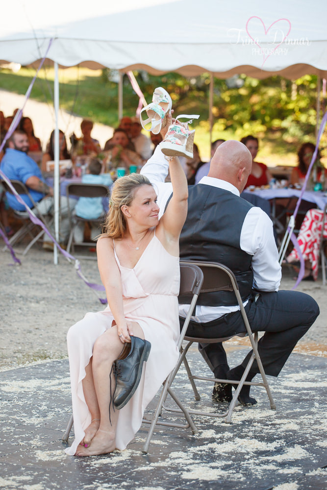 Shoe game at a rustic Maine wedding photographed by Trina Dinnar Photography.