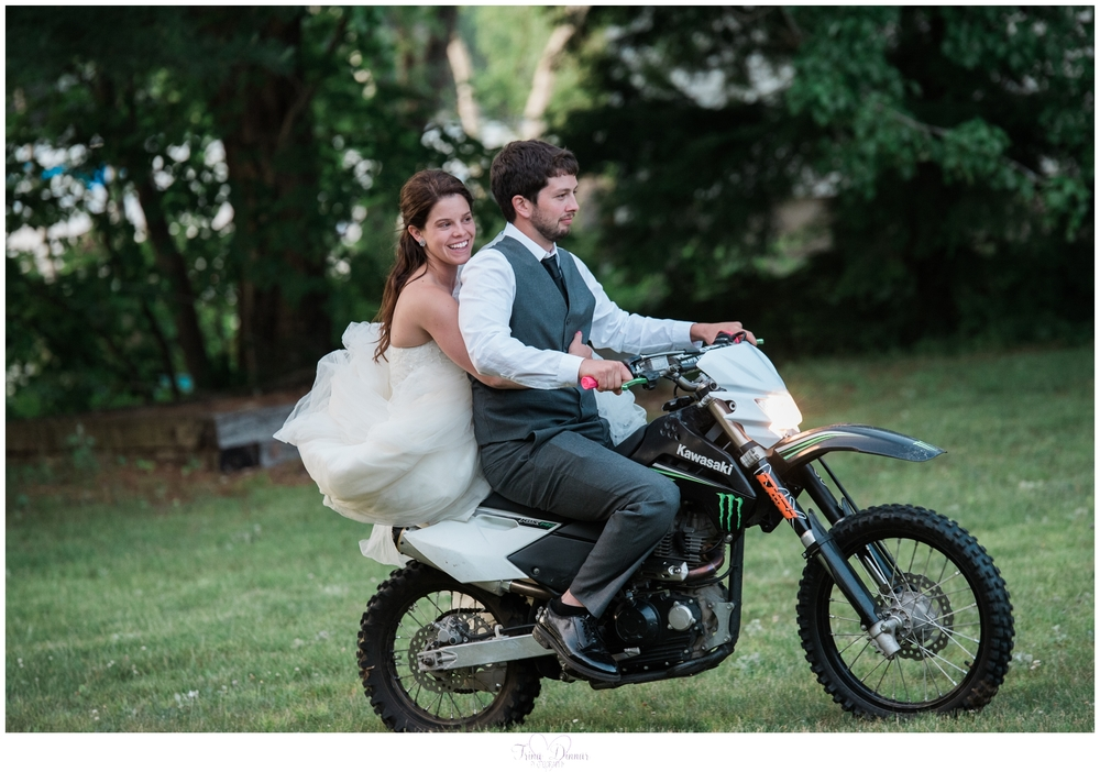 Bride and groom on dirt bike in Peru, Maine.