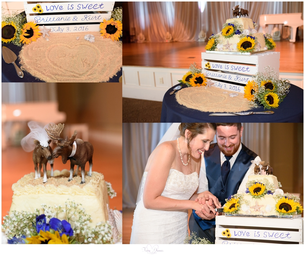 """Love is sweet"" sunflower wedding cake with Maine moose topper. Edible shells and names in sand."