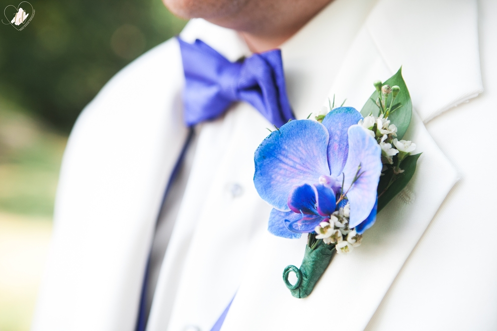 Purple Boutineer on White Suit at a Maine Wedding.